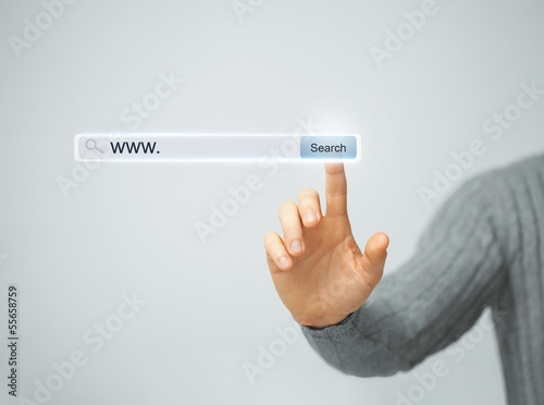 male hand pressing Search button