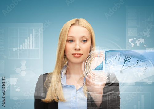 businesswoman pointing at graph