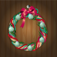 christmas wreath on wooden texture