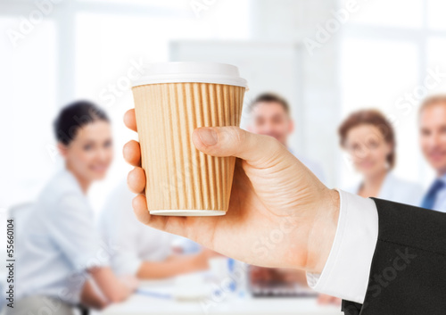 man hand holding take away coffee