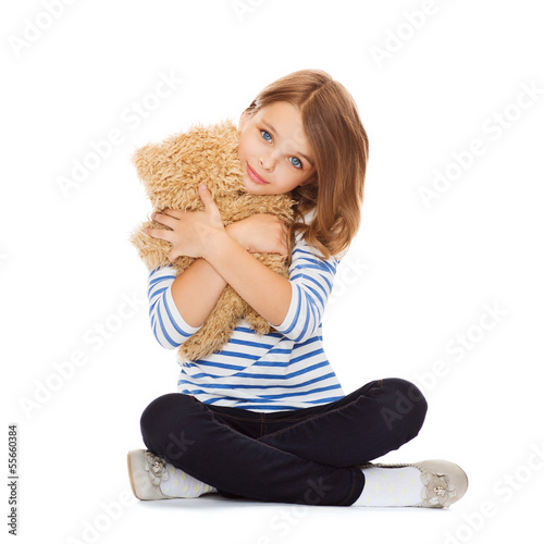 cute little girl hugging teddy bear