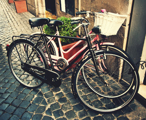 Two classic vintage retro city bicycles, retro tinted photo, Rom