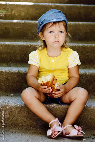 cute toddler eating outdoors