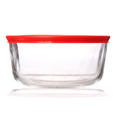 glass food container with red plastic lid isolated