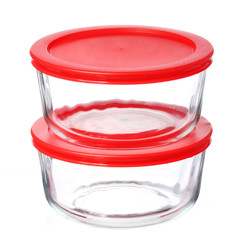 glass food containers with red plastic lids isolated