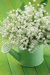 Lily-of-the-valley posy  in a watering can