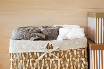 basket of towels on wooden