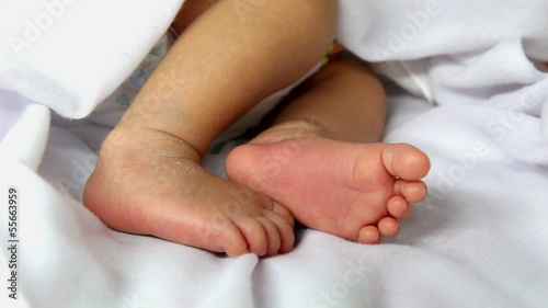 Closeup to cute newborn baby's feet , one week age