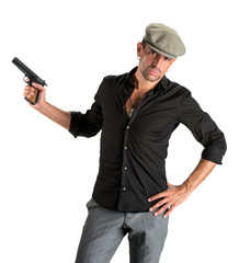 Handsome man in cap with a gun