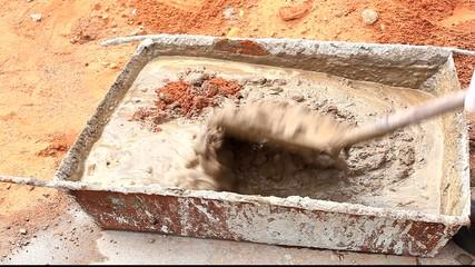 Woker mixing cement