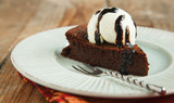 Piece of chocolate almond cornmeal cake with balsamic drizzle an