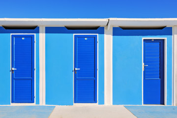 Brightly coloured beach huts in Rimini