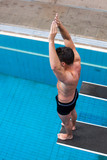 Man wants to jump from spring board at swimming pool