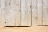 wooden door on a sandy beach