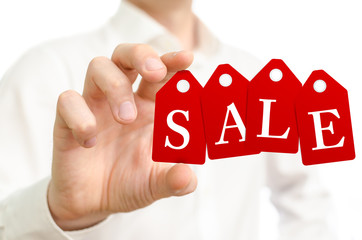 Man holding sale red labels on white background