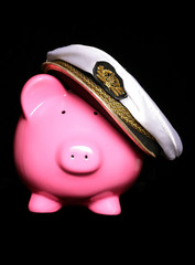 piggy bank wearing sailors hat