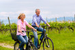 Seniors exercising with bicycle