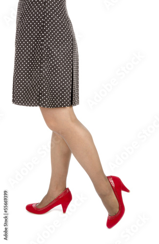 Woman Wearing Mini Skirt with Polka Dots and Red Suede Pumps