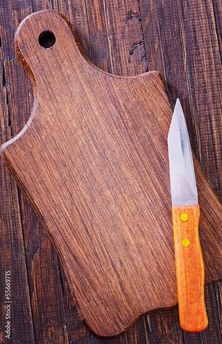 knife on wooden board
