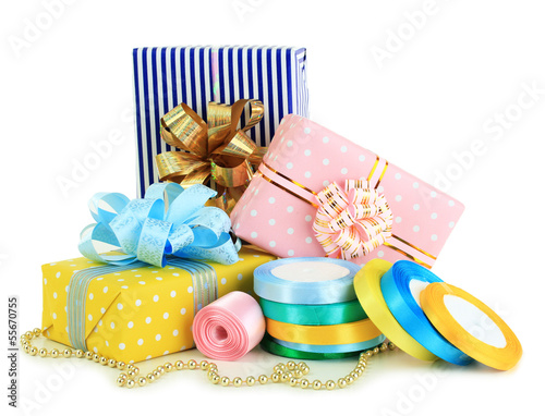Tapes for wrapping gifts with holiday gifts isolated on white