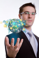 Social Network concept :young business man holding earth of soci