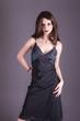 Attractive woman in black dress, goth , studio shot