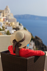 young woman enjoying view of Santorini, Greece