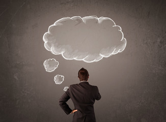 Businessman with cloud thought above his head