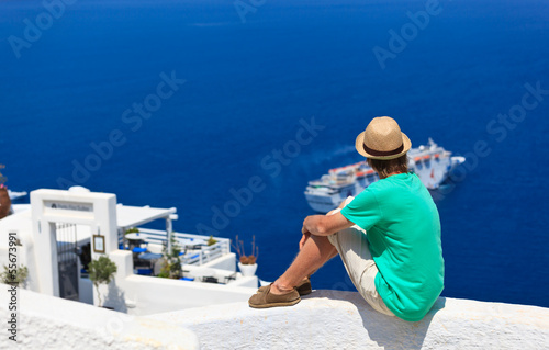 tourist looking at the sea in Santorini