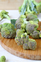 broccoli florets on a cutting board