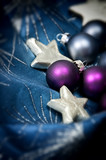 Glittering christmas decoration in purple, blue and gold