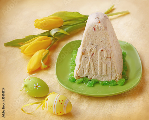 Traditional Russian curd easter paskha on a yellow background