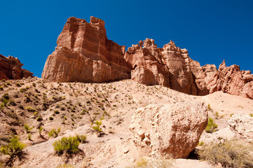 Rock formations at Charyn canyon under blue sky. Kazakhstan