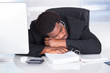 Stressed Businessman Sleeping In Office