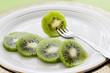 Kiwi sliced on a plate.
