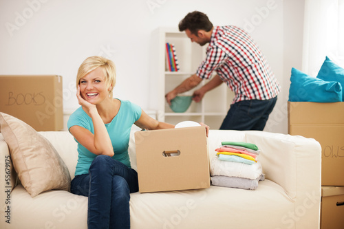 Couple decorating their new living room