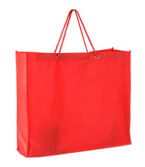 red tissue shopping bag isolated on white