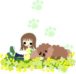 犬と一緒に野原で休む少女