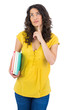 Pensive curly haired student holding notebooks
