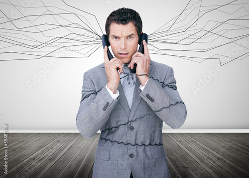 Businessman trapped by telephone wires