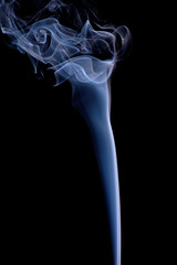 Smoke or Steam Rising against a Black Background