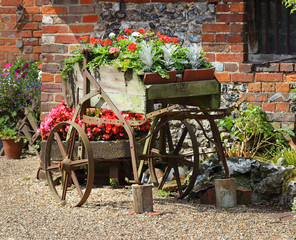 Flower display in a rustic cart