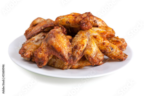 Leinwanddruck Bild Plate of delicious barbecue chicken wings, on white