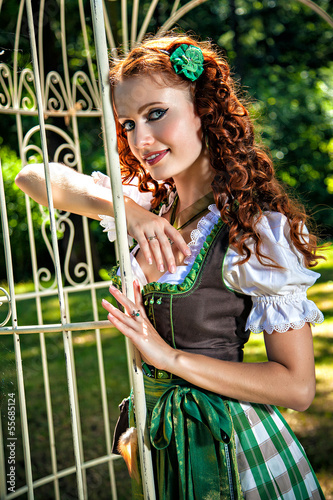 Romantic bavarian girl in the garden