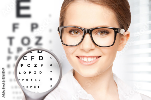 woman with magnifier and eye chart - 55685147