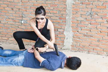 Suspect under arrest by policewoman.
