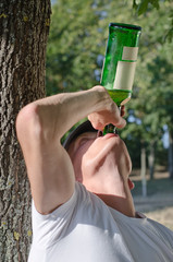 Alcoholic gulping down alcohol
