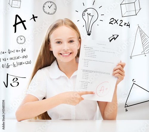 girl with test and A grade at school