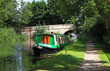 Narrowboat moored on a Canal - 55685756