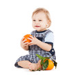 cute toddler eating orange